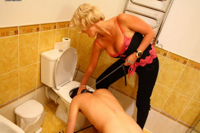 Naked slave has head pushed into toilet bowl by mistress