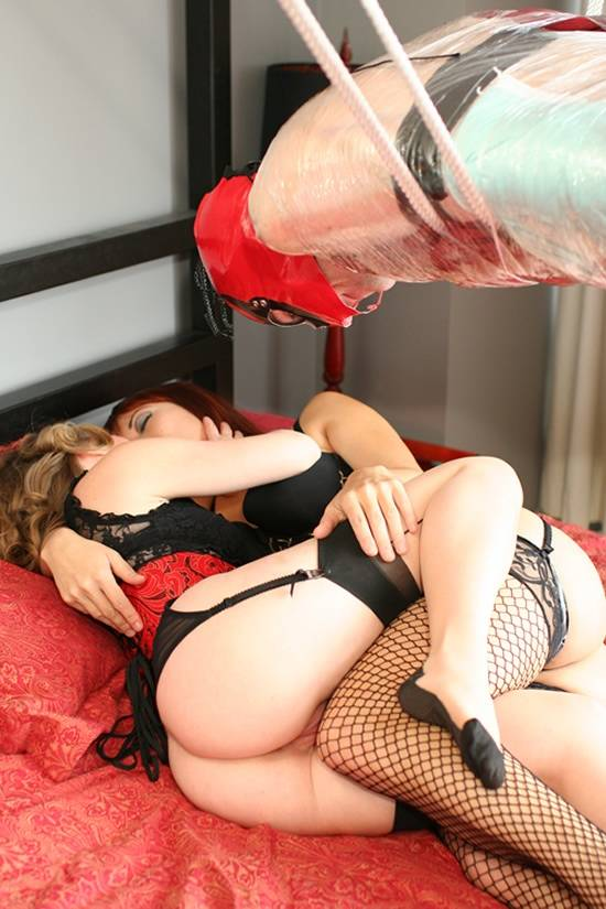 Mistress T with female lover and suspended slave