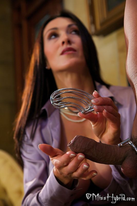 Mistress attaching chastity device