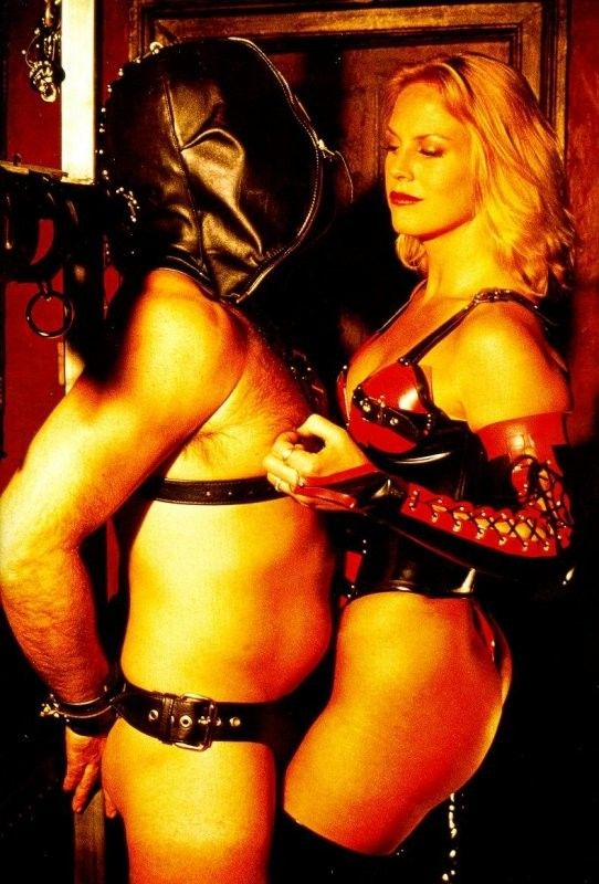 Hooded slave with mistress