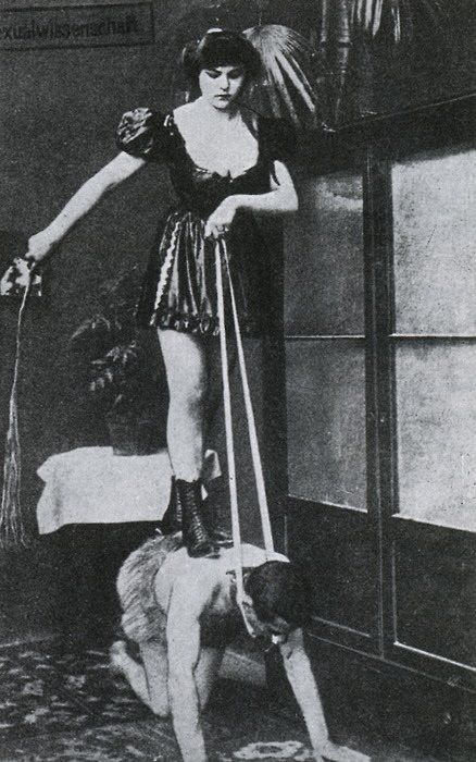 Vintage domination shot featuring domme riding on back of slave