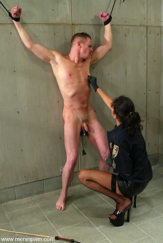 Cole Conners in police outfit with naked male prisoner