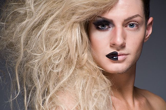 Pusse Couture in half drag. Photographed by Leland Bobbé