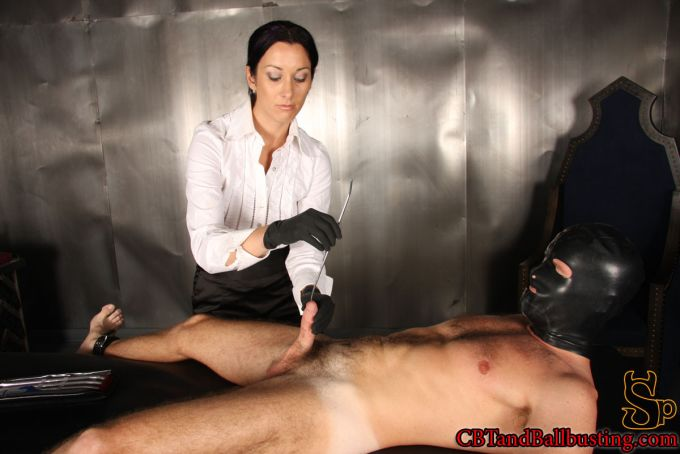 January Seraph inserting a urethral sound