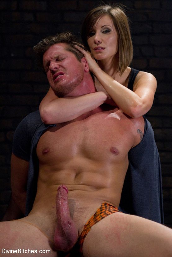 Domme holds man by neck
