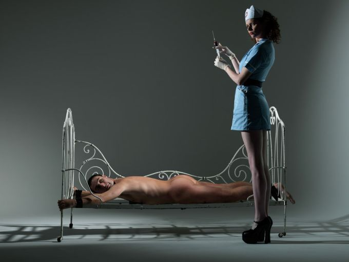 Nurse and patient in a photograph by Peter Coulson