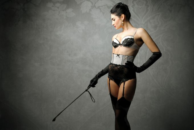 Lacy lingerie and riding crop