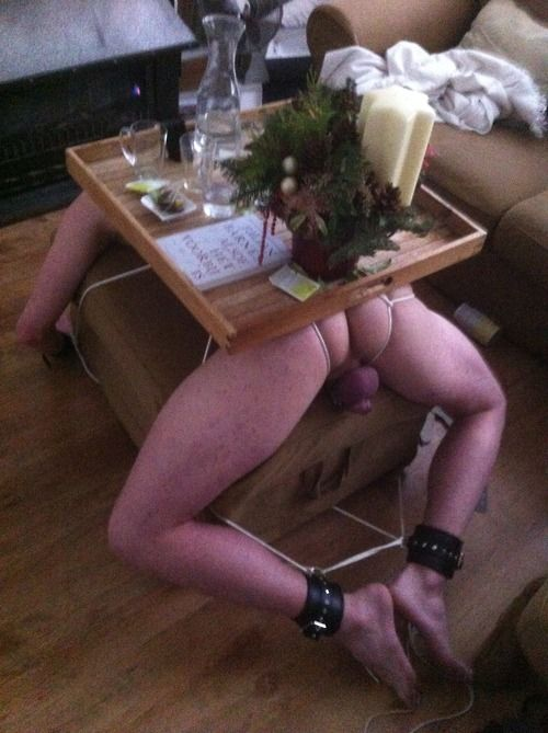 Man in bondage as a coffee table