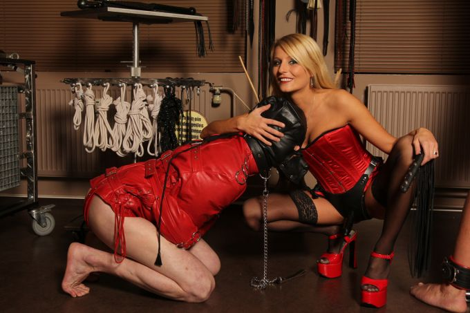 Lady Natalie Black with hooded slave